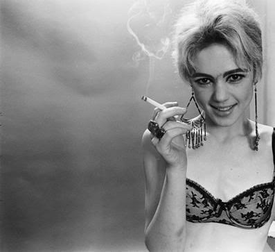 black-and-white photograph of Edie Sedgwick in a black bra and smoking a cigarette