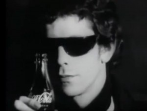 Andy Warhol's Factory: Screen Tests: Lou Reed. Lou Reed wears sunglasses and drinks a bottle of Coca Cola.