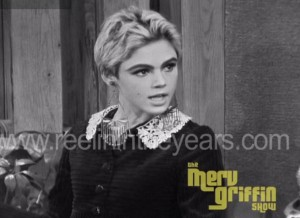 Screen cap of Merv Griffin Show. Black-and-white photograph of Edie Sedgwick.