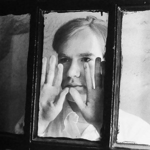 Coursera Certificate Warhol: Andy Warhol looking through a window