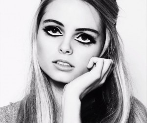 Black-and-white fashion photograph of Blondie Gamon modeling the finished look from her Edie Sedgwick Makeup Tutorial