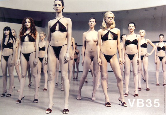 "Teatime on Mars: photo of Vanessa Beecroft performance artwork ""VB35"" with models, some in bikinis and some naked, standing in the rotunda of the Guggenheim Museum in New York"
