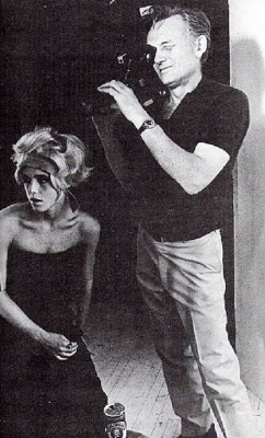 black-and-white photograph of Edie Sedgwick with a hair band and Ricky Leacock holding a camera. Filming scenes for Sarah Caldwell production of Lulu, August, 1967