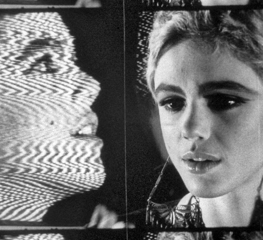 Frame from Andy Warhol's Outer and Inner Space featuring a filmed Edie Sedgwick in front of a video Edie Sedgwick on a TV monitor